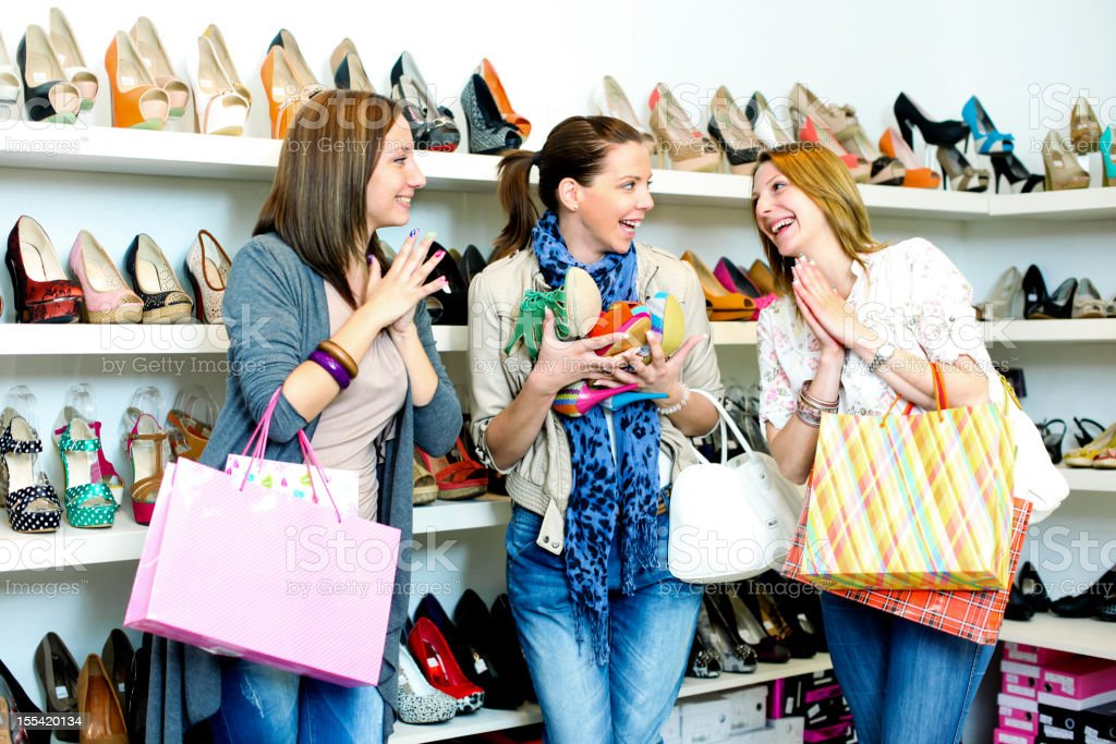 Young Smiling Women Inside of Shoes Shop. royalty-free stock photo