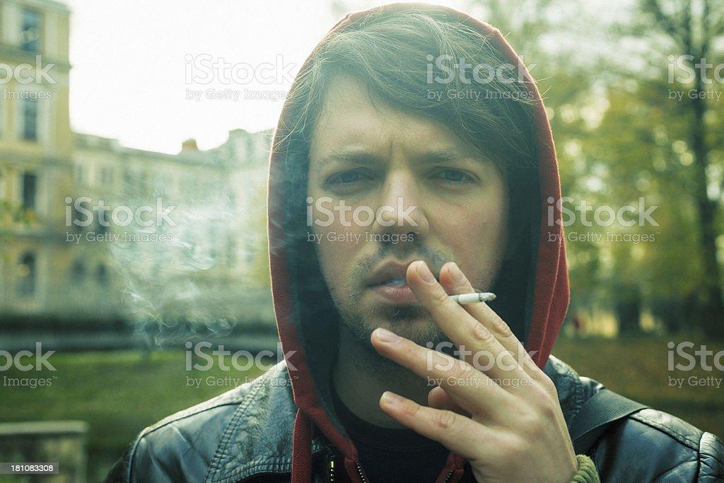 Young smoking man royalty-free stock photo