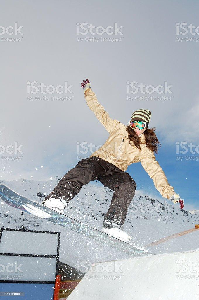 young snowboarder woman jibbing royalty-free stock photo
