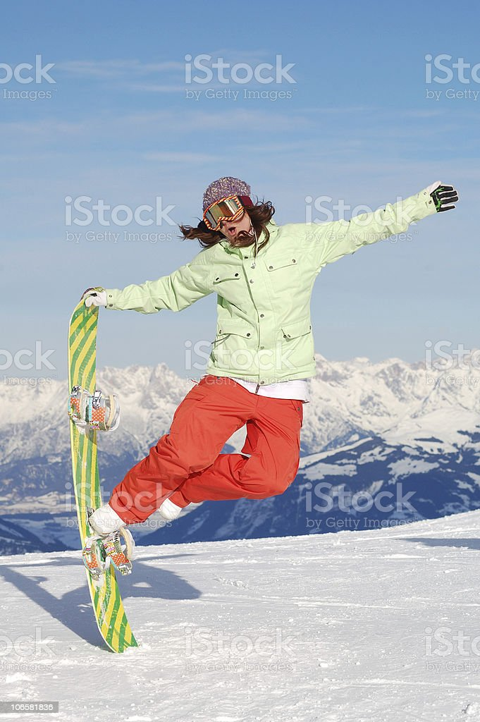 young snowboarder woman jumping royalty-free stock photo