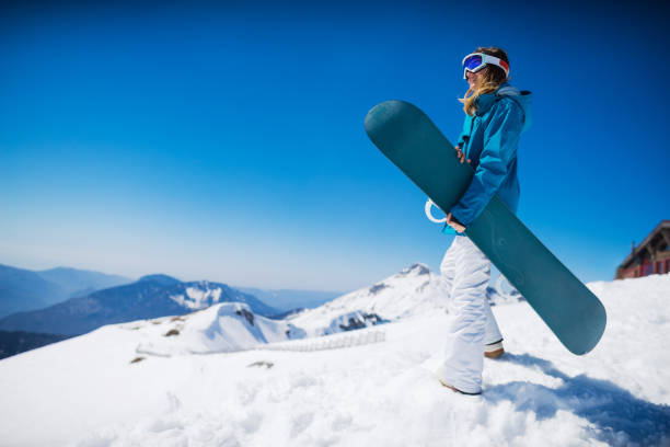 young  snowboarder woman