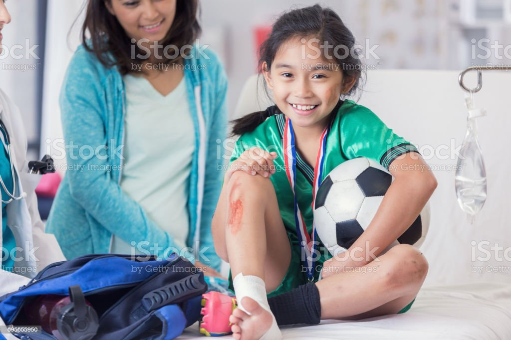 Young soccer champion with injuries stock photo