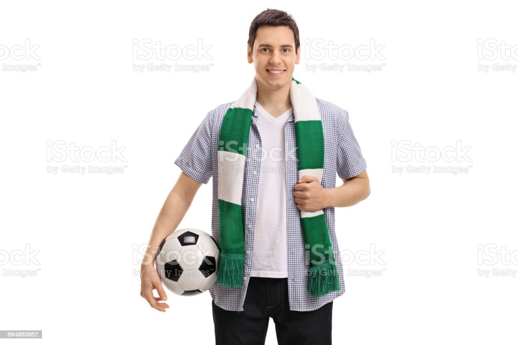 Young soccer fan with a scarf and a football stock photo