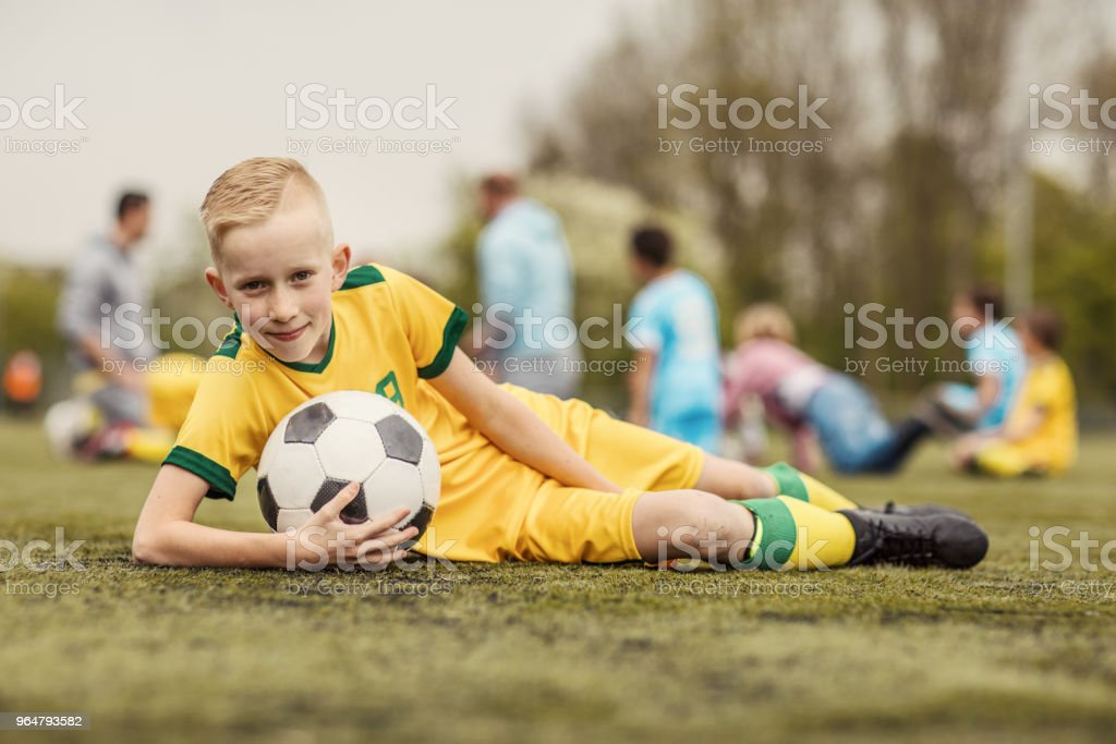 A young soccer player boy posing for individual photo during a football training session royalty-free stock photo