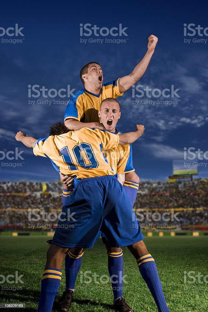 Young Soccer Players Celebrating a Goal royalty-free stock photo