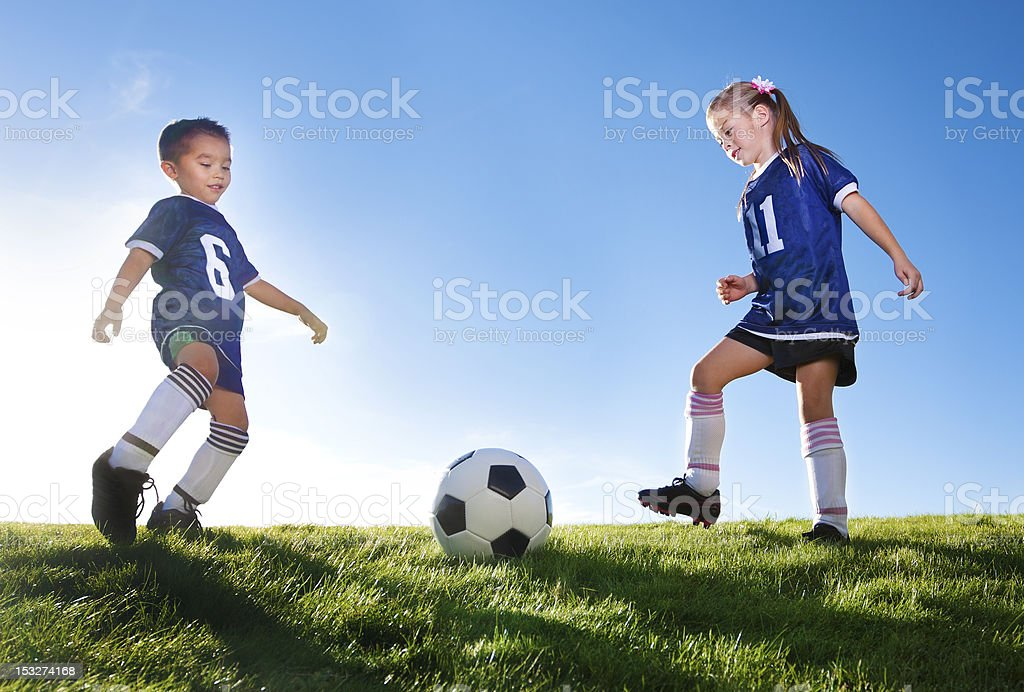 Young Soccer Players Kicking Ball stock photo
