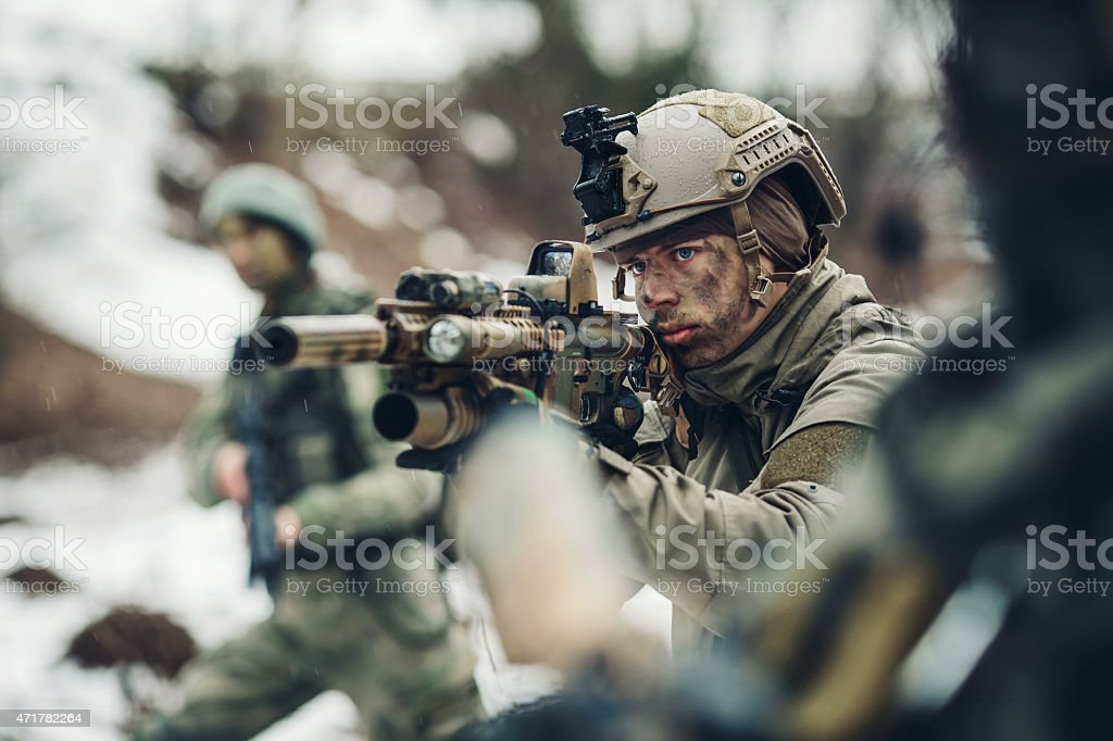 young soldiers with guns stock photo