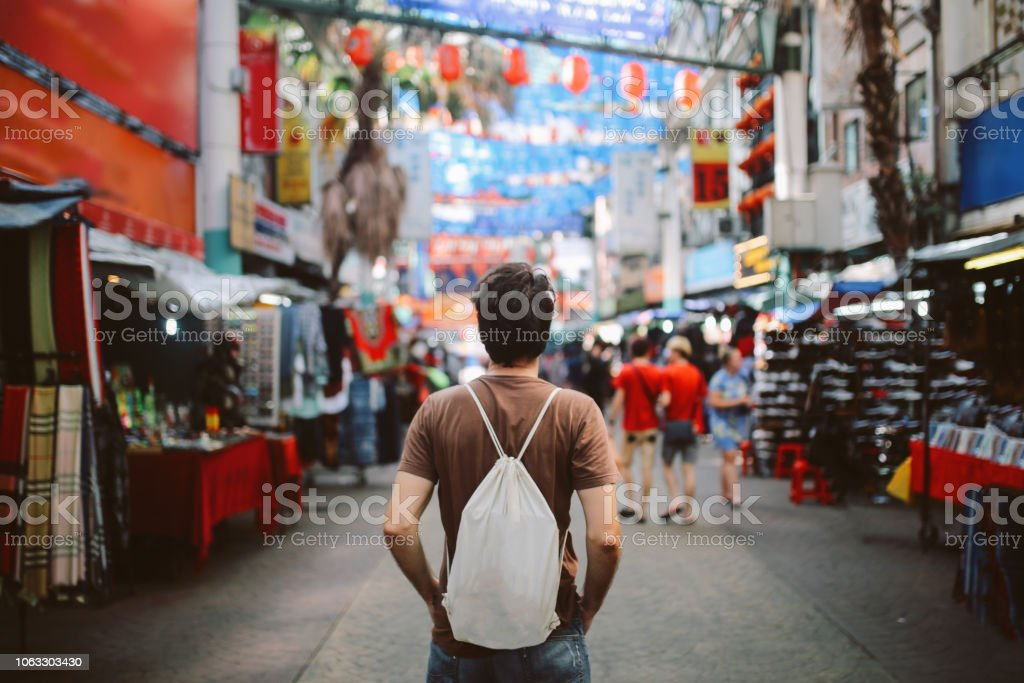 Young solo traveler in Kuala Lumpur Chinatown district stock photo