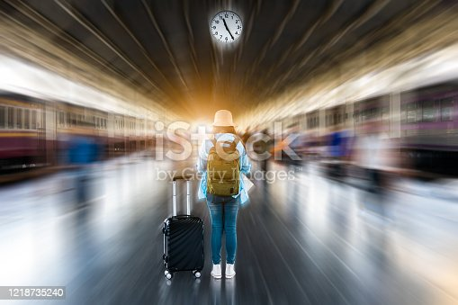 Blurred motion speed train background with solo woman traveler waiting depart time at platform