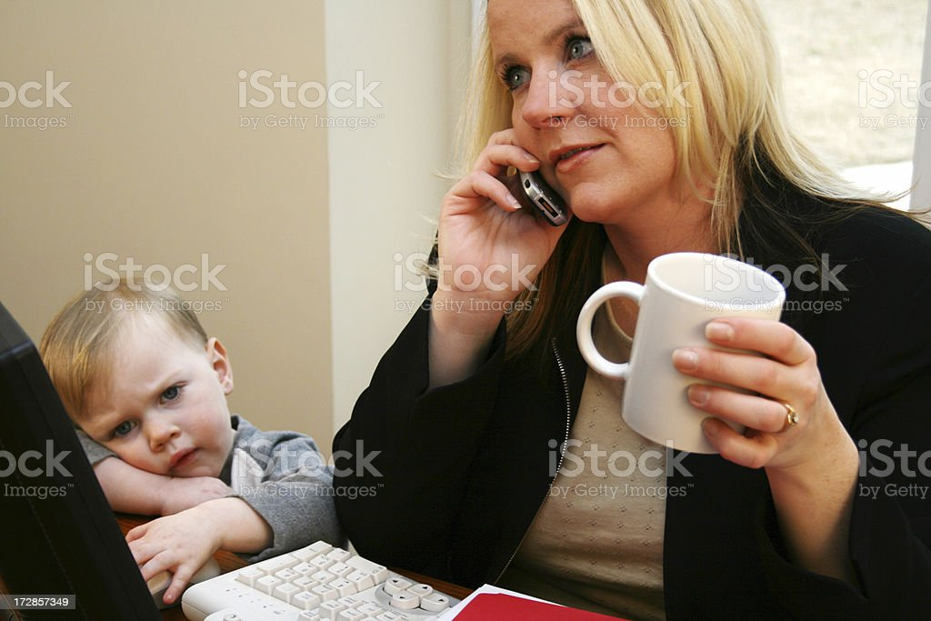 Young Son With His Career-Minded Mother royalty-free stock photo