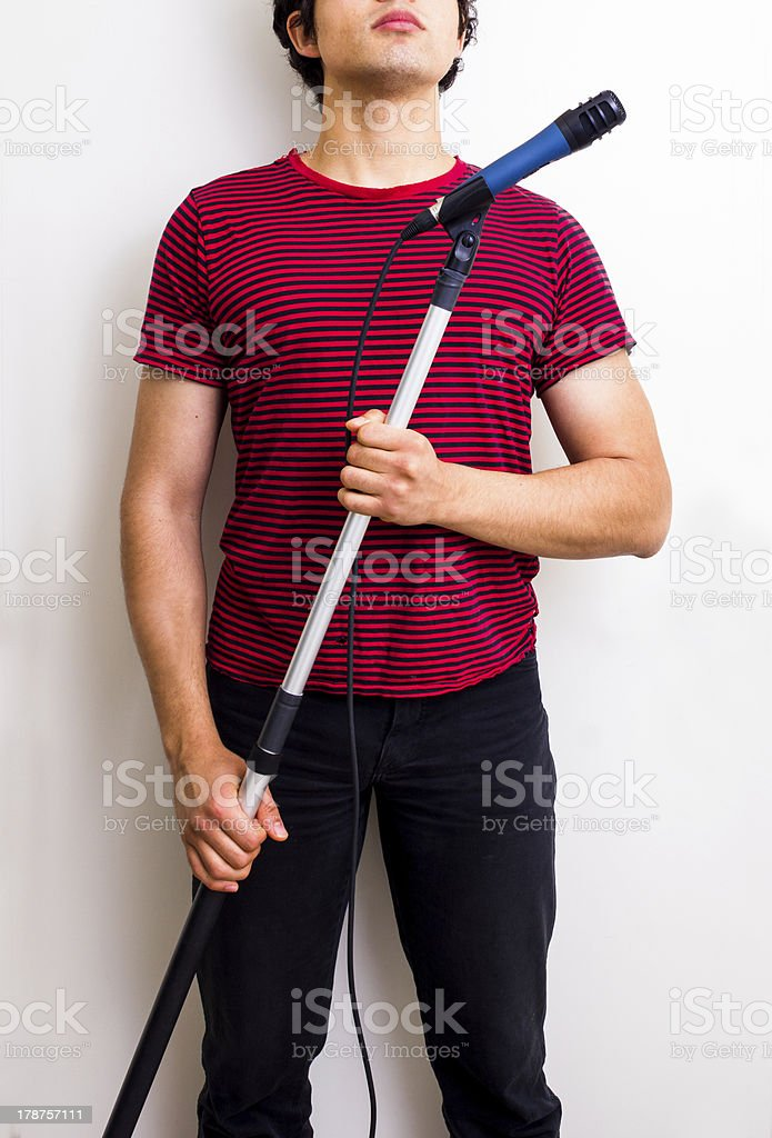 Young sound man with boom stock photo