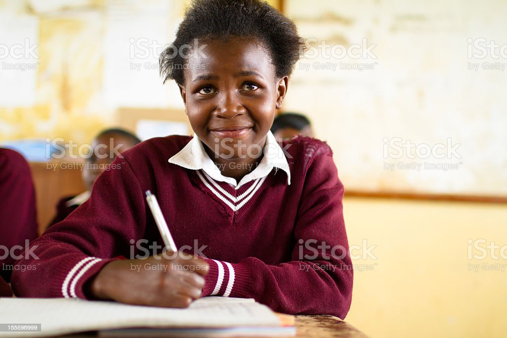 Young South African girl in classroom stock photo