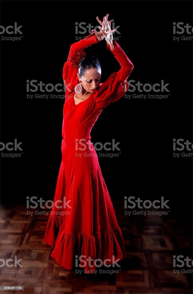 a43846845648 Young Spanish woman dancing flamenco in traditional folk red dress - Stock  image .