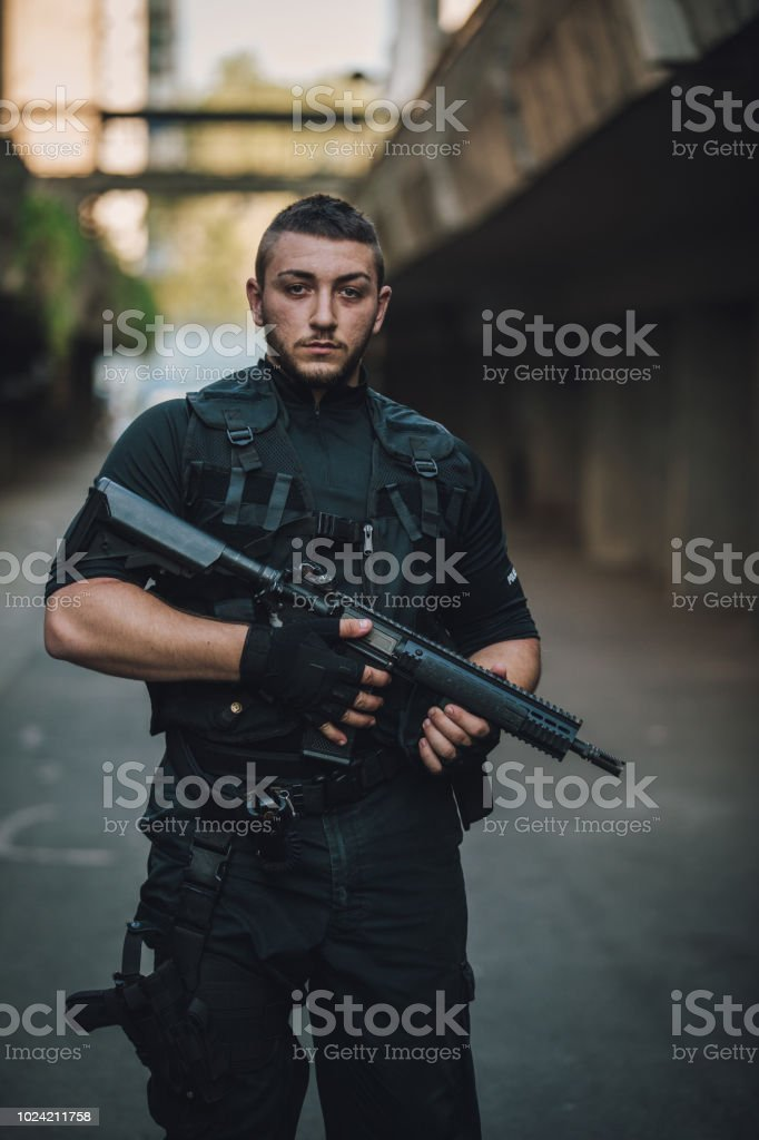 One man, special forces armed man on the street, ready for action.