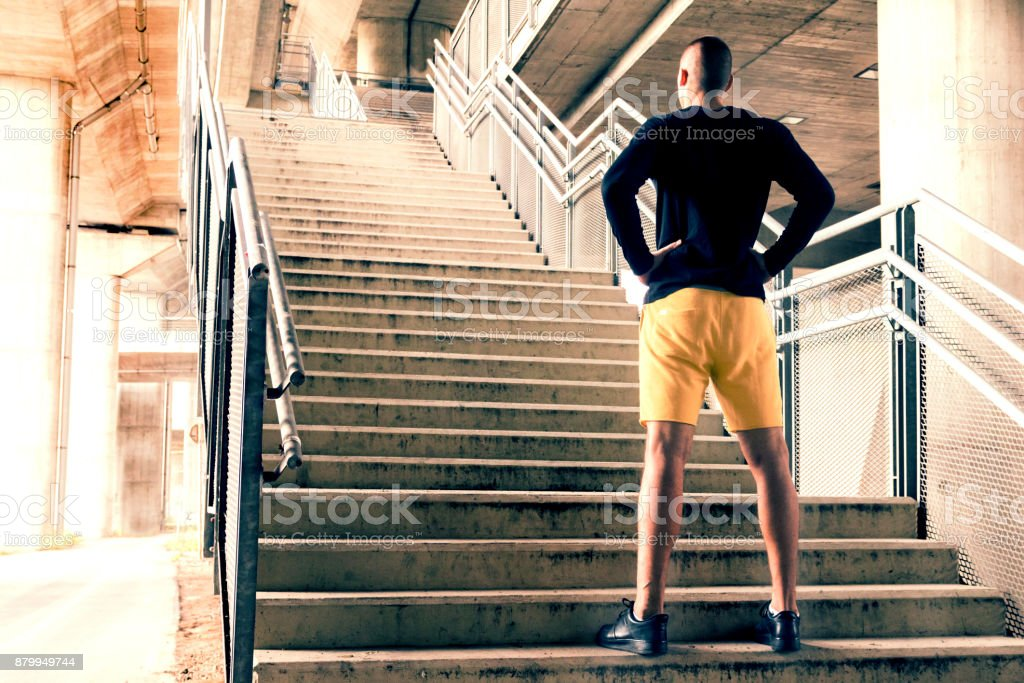 Young sport man preparing for a challenge in urban environment. stock photo