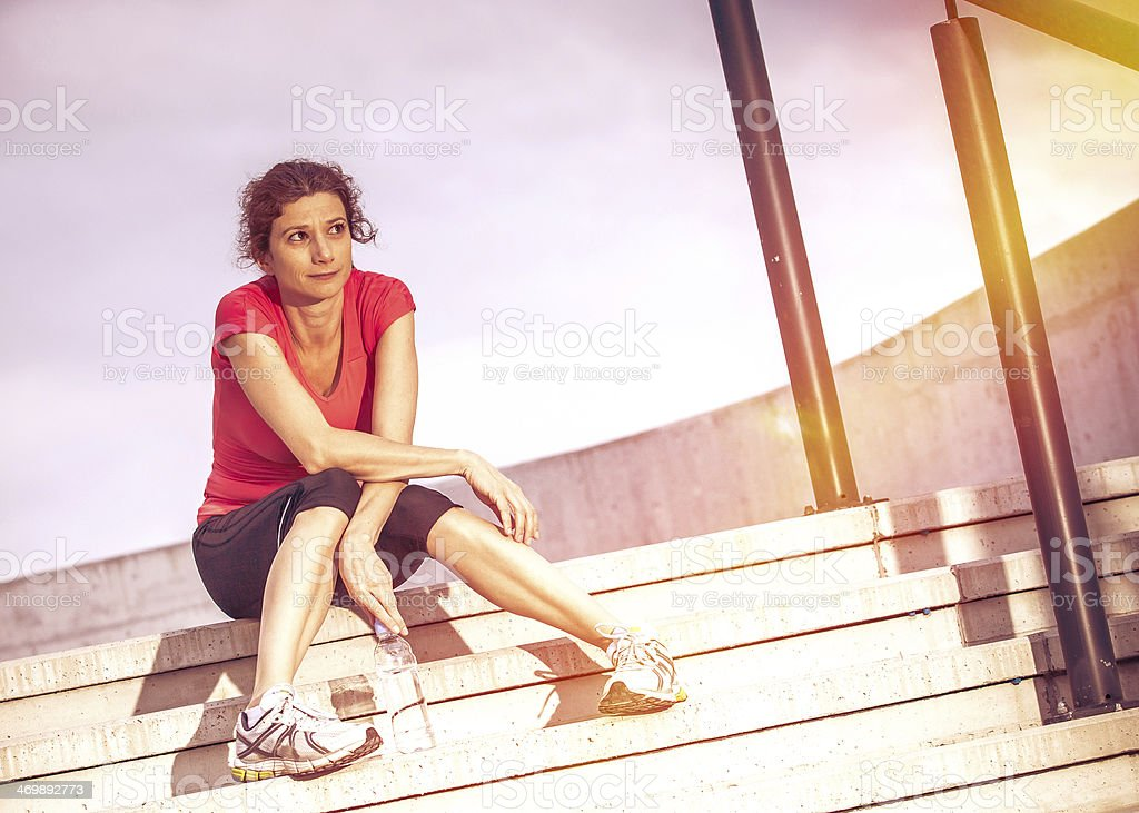 Young sporting woman rest after jogging royalty-free stock photo