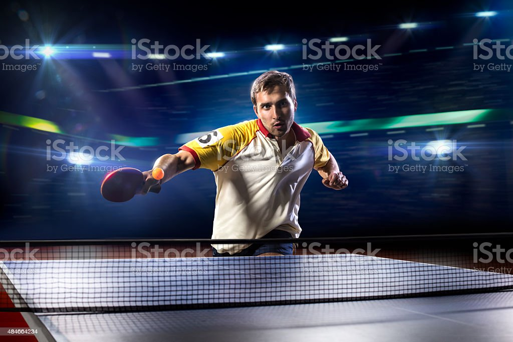 young sports man tennis player playing on black background with stock photo
