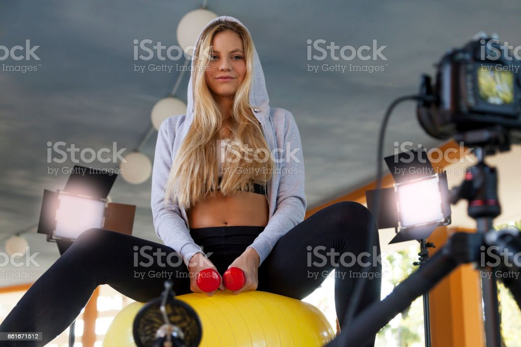 young sports woman blogger making a videos stock photo