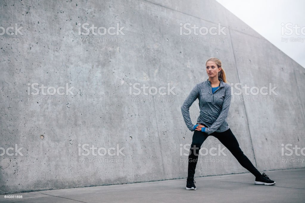 Young sports woman exercising outdoors stock photo