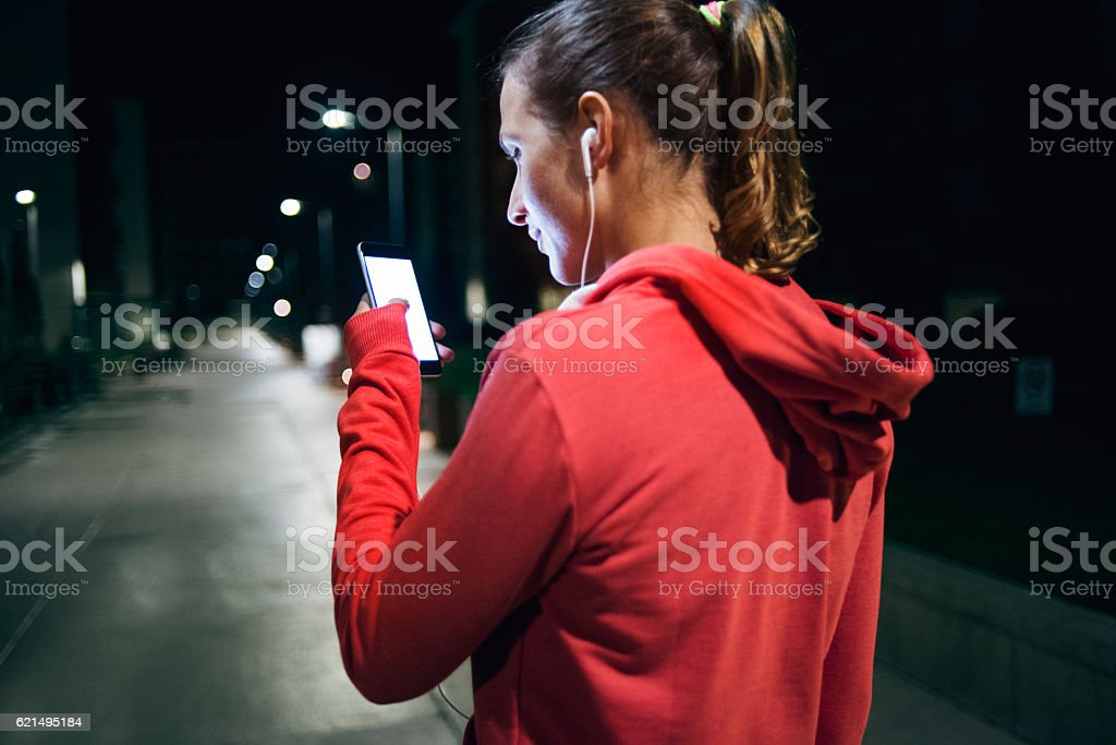 Young sports woman looking at the phone Lizenzfreies stock-foto