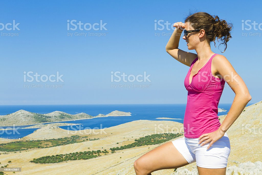 young sports woman shielding her eyes stock photo