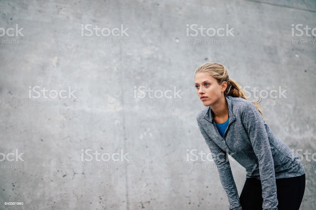 Young sports woman taking break after a run stock photo
