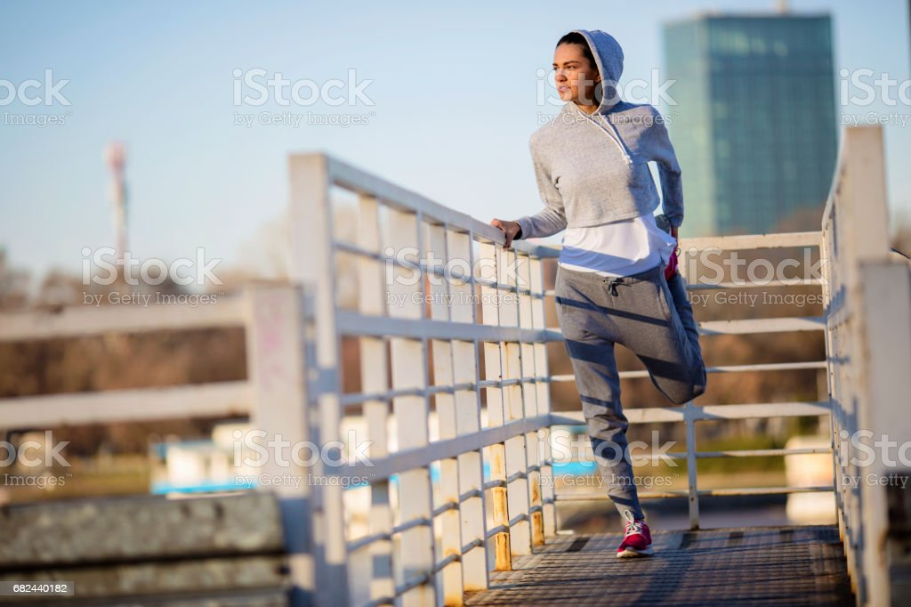Young sports woman warm up outdoor royalty-free stock photo