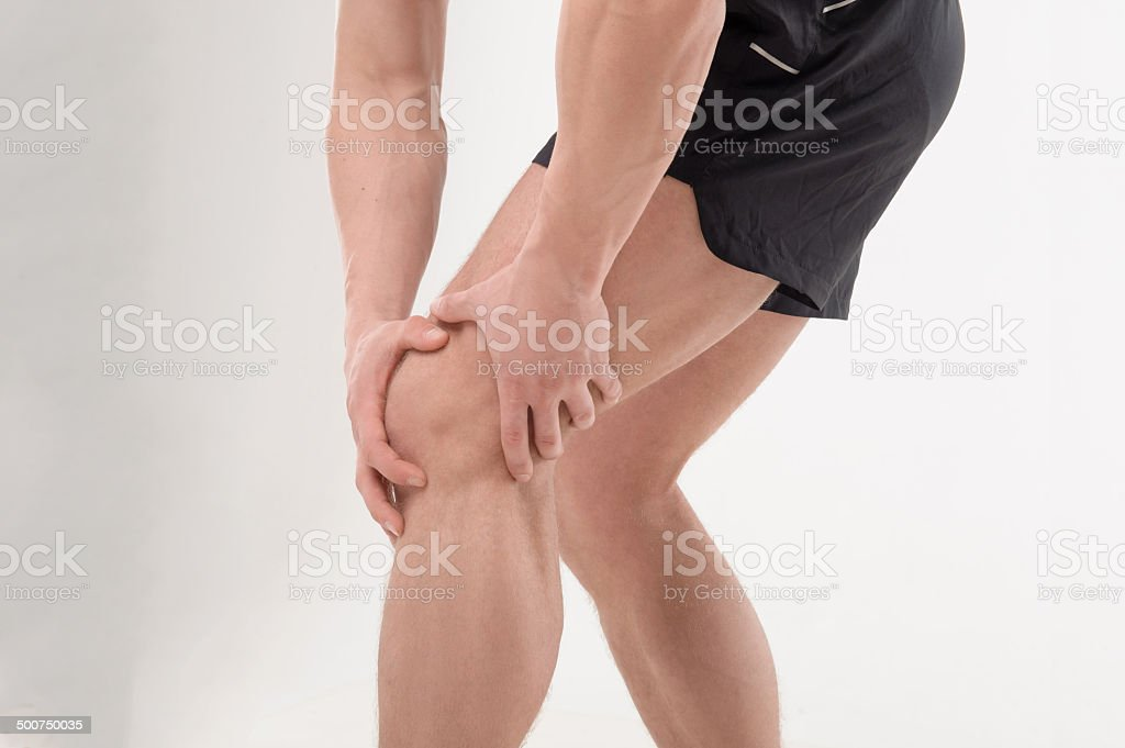 Young sportsman feeling pain stock photo