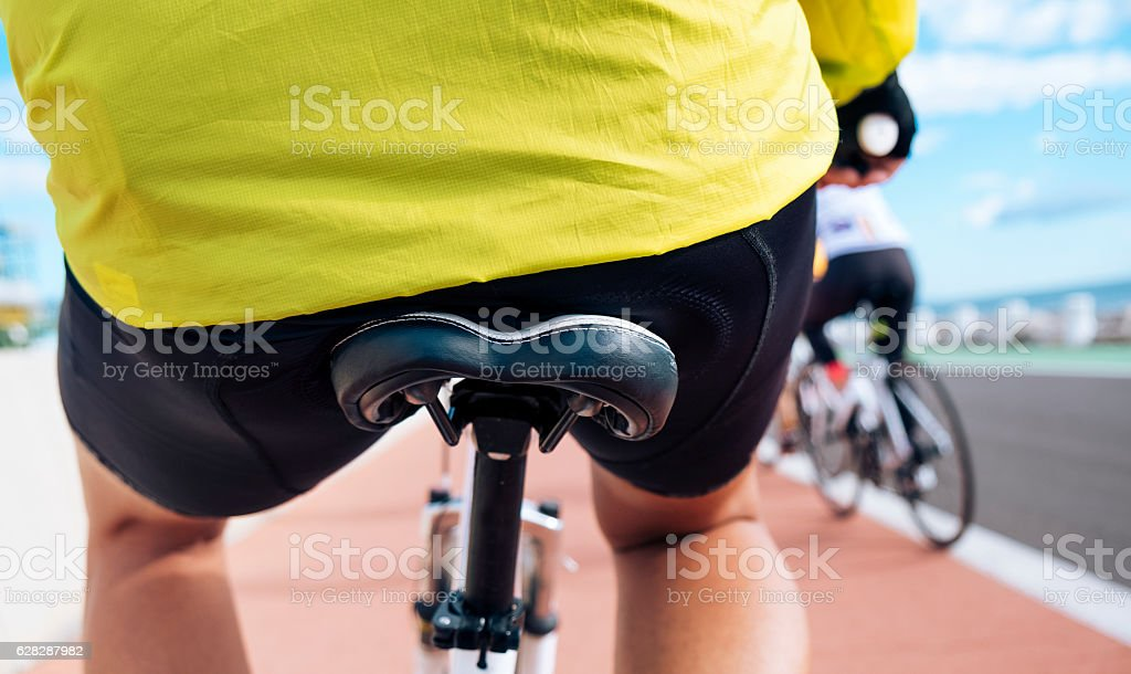 young sportsman riding his bicycle stock photo
