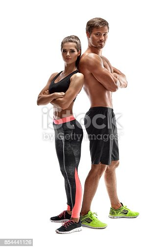 istock Young sportsmen couple woman and man in studio on white background 854441126