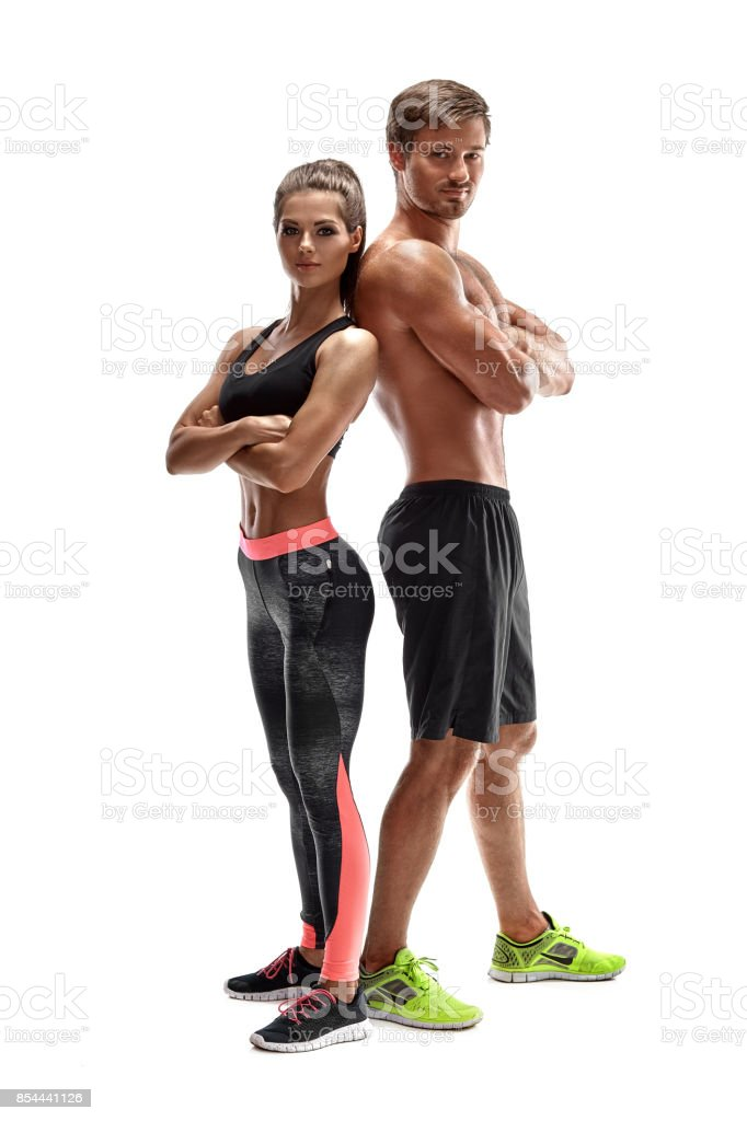 Young sportsmen couple woman and man in studio on white background stock photo