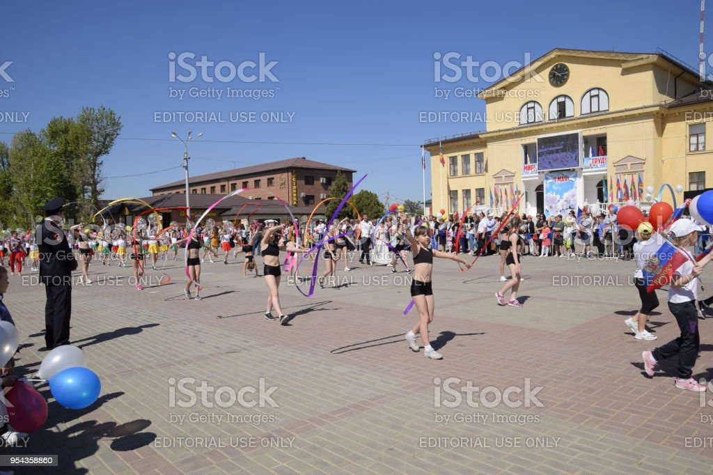 Young sportsmen of city sports schools. Celebrating the first of May, the day of spring and work. May Day parade on the Theater Square in the city of Slavyansk-on-Kuban. stock photo