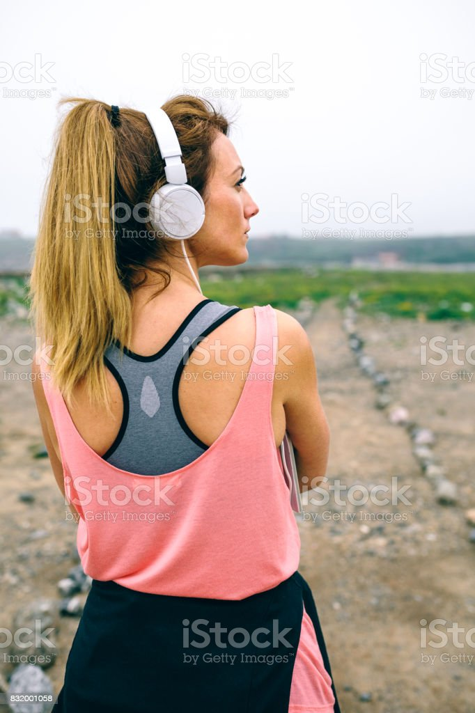 Young sportswoman in front of the way to go stock photo
