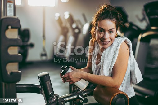 619088796 istock photo Young sportswoman lifting weights in gym 1081576148