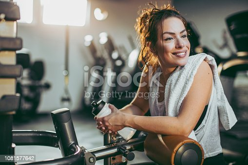 619088796 istock photo Young sportswoman lifting weights in gym 1081577642