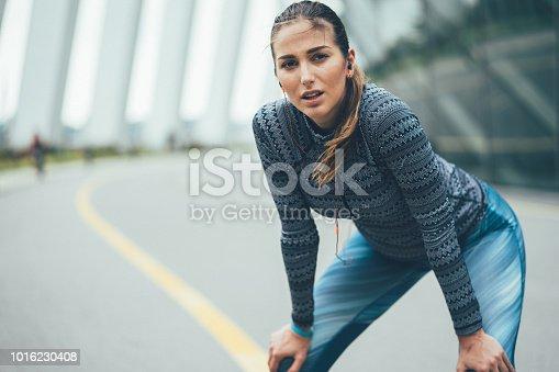 istock Young sportswoman taking breath 1016230408