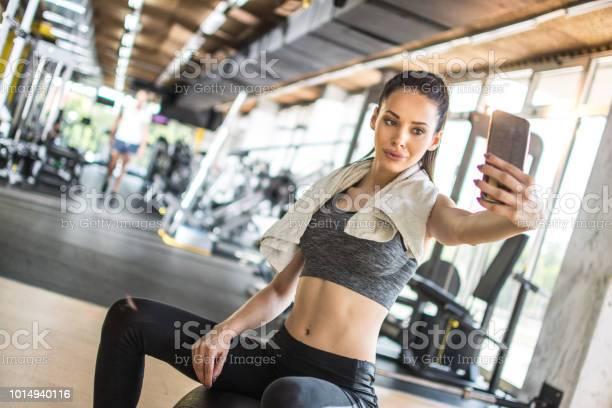 Young sportswoman taking selfie after sports training in gym picture id1014940116?b=1&k=6&m=1014940116&s=612x612&h=q muh5yfuobgelbr8u0hyhvb1pfnnafkewglyx7b vc=