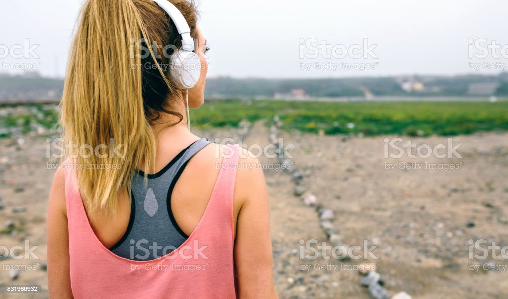 Young sportswoman watching the way stock photo