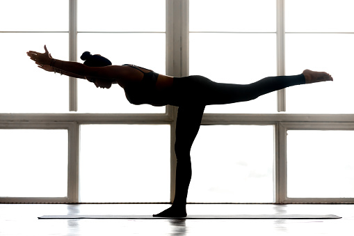 Young Sporty Attractive Woman Practicing Yoga Doing Warrior Three Stock Photo - Download Image Now