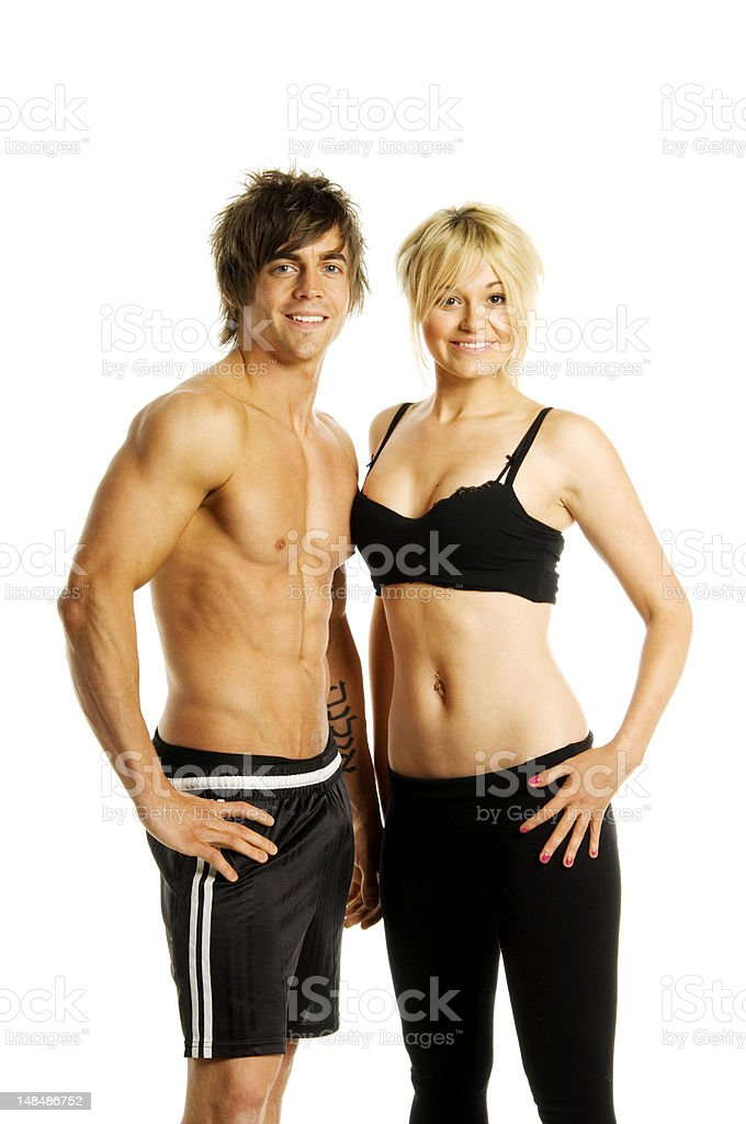 Young sporty couple on White background stock photo