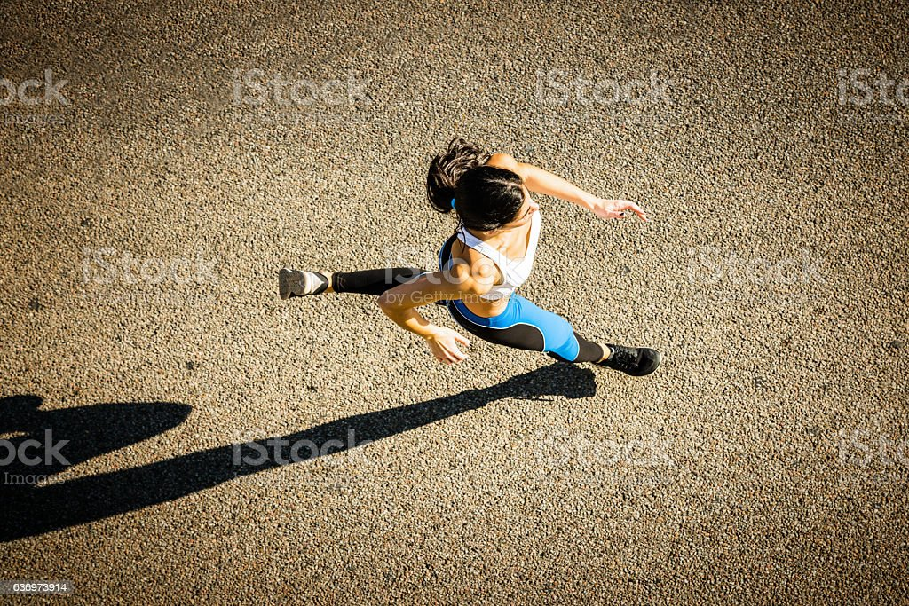 Young sporty looking woman running stock photo