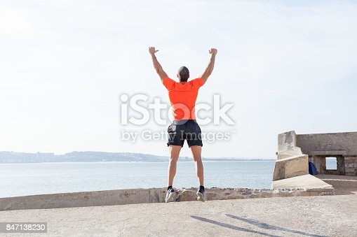 istock Young Sporty Man Jumping Outdoors in Summer 847138230
