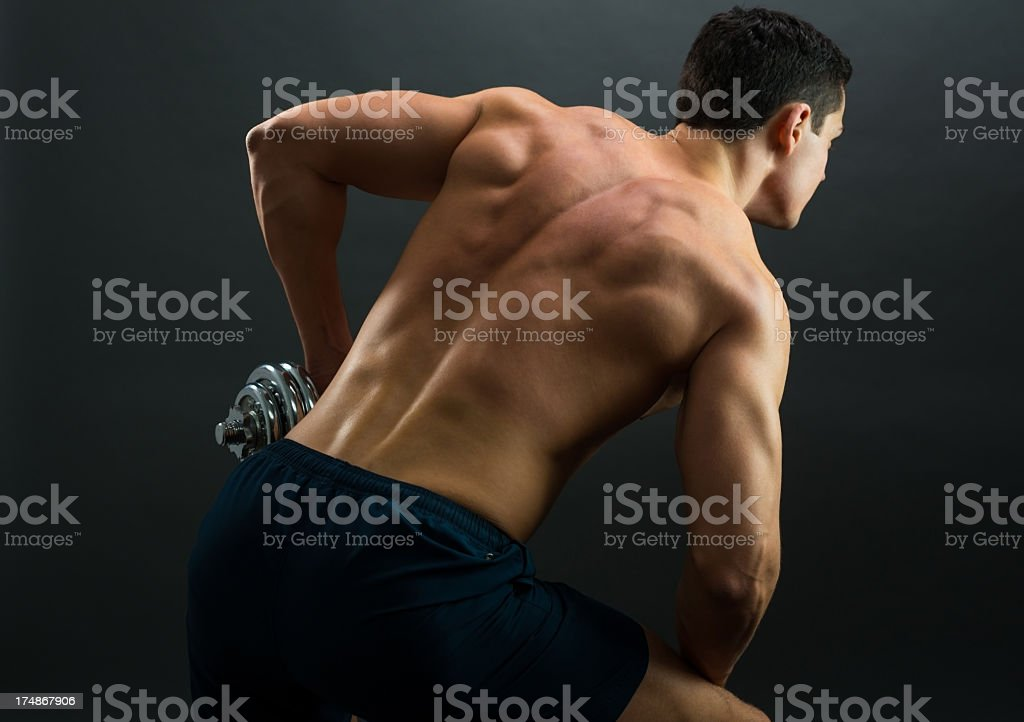 Young sporty man over grey background royalty-free stock photo