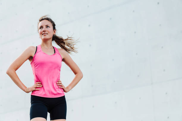 young sporty woman in modern business district stock photo