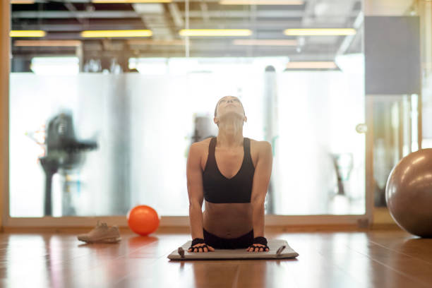 Young sporty woman practicing yoga, doing upward facing dog exercise Yoga, Women, Stretching, Domestic Life, Sun upward facing dog position stock pictures, royalty-free photos & images