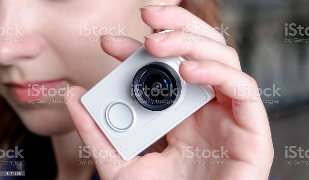 Young sporty women with unrecognisable action camera in hands stock photo