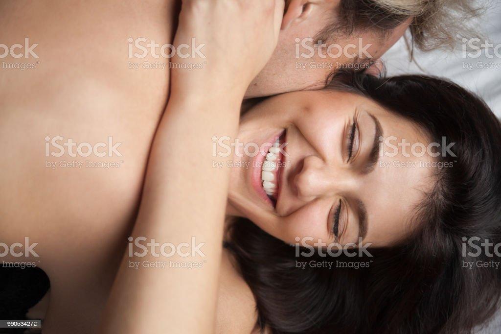 Young husband hugging and kissing beautiful wife enjoying romantic...