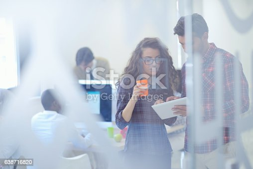 istock young startup business people, couple working on tablet computer 638716820