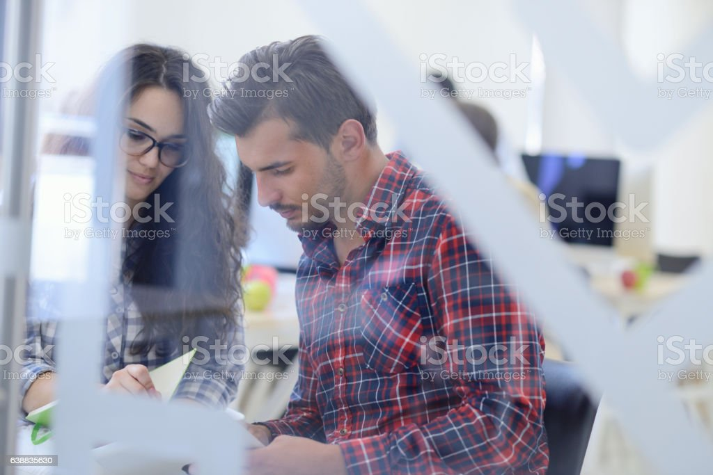 young startup business people, couple working on tablet computer stock photo