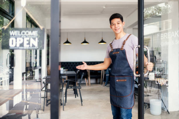 Young startup coffee cafe owener open and welcome customer. stock photo